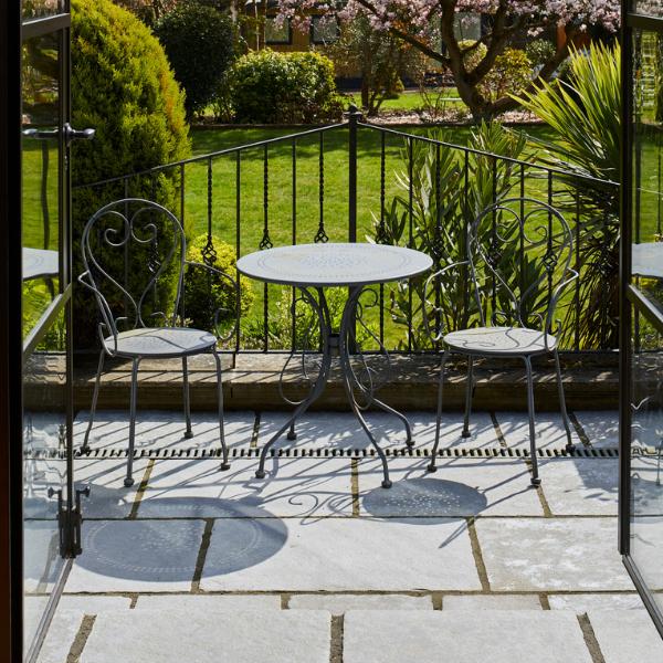 Denham Limestone Seasoned Finish on an outside seating balcony