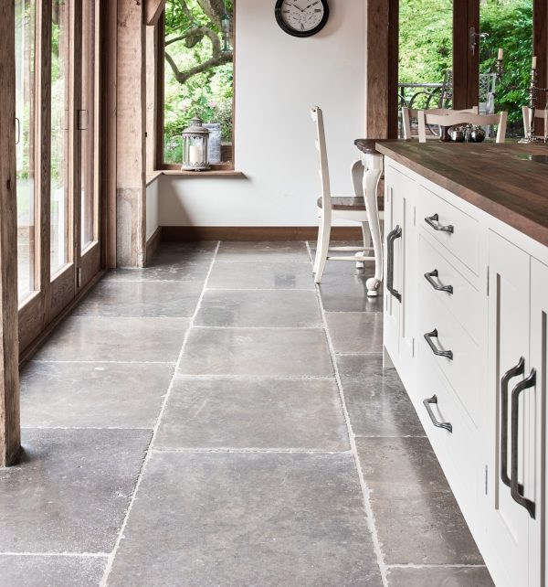 Hazlebury Limestone Seasoned Finish in a rustic kitchen surrounding