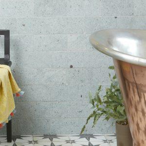 Jakarta Quartzite Brick Sawn Finish Beside a Bronze Bathtub