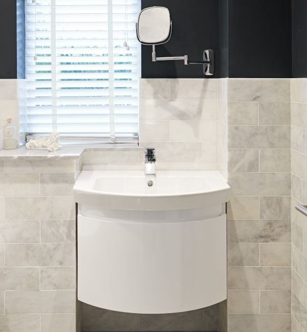 Long Island Marble Honed Finish surrounding a sink in a modern bathroom