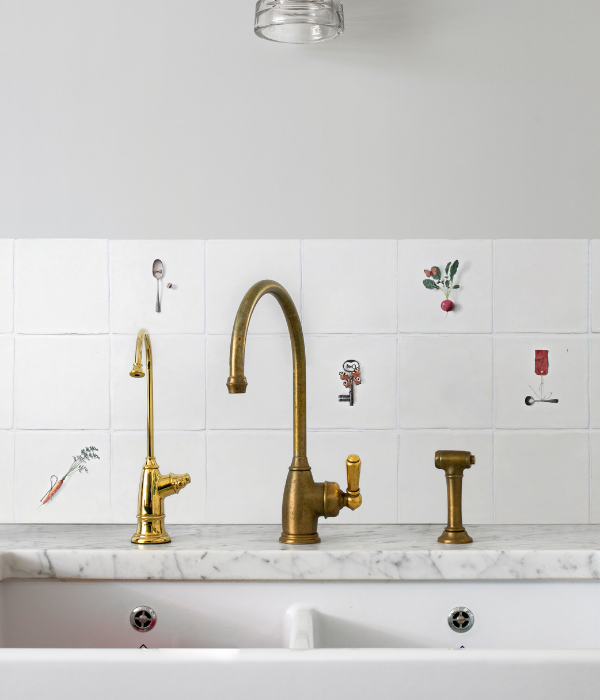 Menagerie Ceramic By Michael Angove Surrounding a sink with a golden tap