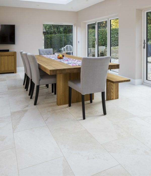 Naturalis Marble Honed Finish under a stylish kitchen table