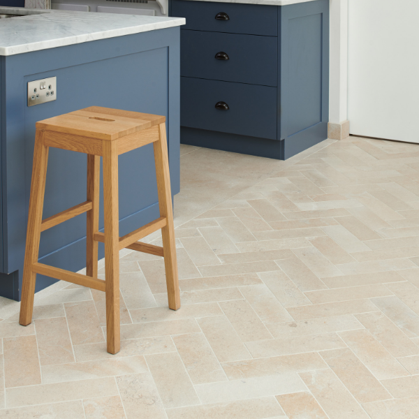 Neranjo Limestone Brick Velvet Finish Inside a contrasting kitchen