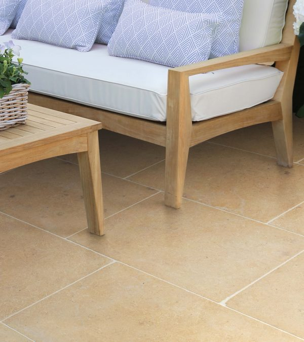 Neranjo Limestone Tumbled & Etched Finish in a warm conservatory