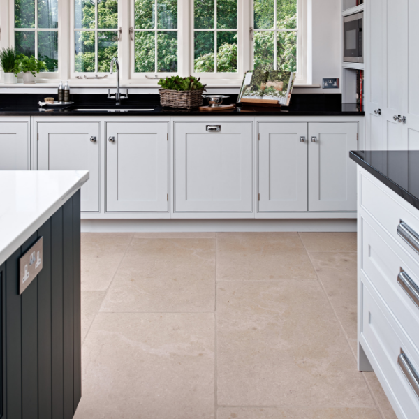 Neranjo Limestone Tumbled Finish surrounded by contrasting kitchen cupboards