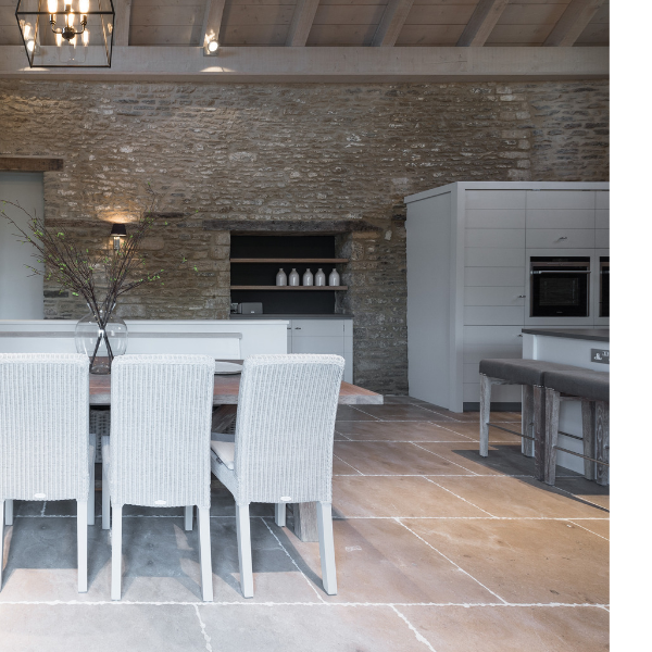 Neranjo Seasoned Limestone in an open plan dining area