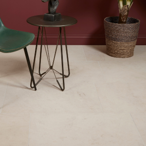 Swanage Limestone Honed Finish floor with a chair and table