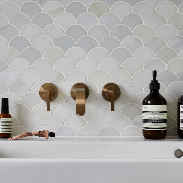Zen Marble Scallop Mosaic In front of a sink